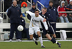 13 December 2009: Akron's Zarek Valentin (2) and Virginia's Will Bates (right). The University of Akron Zips played the University of Virginia Cavaliers at WakeMed Soccer Stadium in Cary, North Carolina in the NCAA Division I Men's College Cup Championship game.