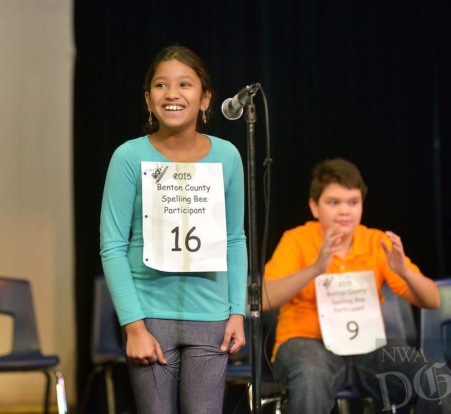 NWA Democrat-Gazette/BEN GOFF -- 01/17/15 Pavani Chittemsetty, 8, reacts after spelling her final word correctly   and being declared the winner during the Benton County Spelling Bee in White Auditorium at Northwest Arkansas Community College in Bentonville on Saturday, Jan. 17, 2015. The 3rd grader from Elm Tree Elementary in Bentonville will advance to the state bee, with second place finisher Tristan Cooper of Siloam Springs Intermediate serving as alternate.