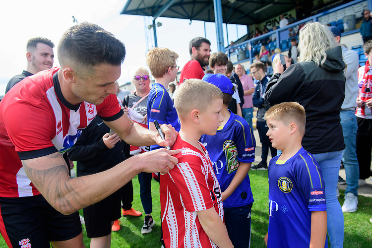 Lincoln City's Jason Shackell signs autographs for fans<br /> <br /> Photographer Chris Vaughan/CameraSport<br /> <br /> Football Pre-Season Friendly (Community Festival of Lincolnshire) - Gainsborough Trinity v Lincoln City - Saturday 6th July 2019 - The Martin & Co Arena - Gainsborough<br /> <br /> World Copyright © 2018 CameraSport. All rights reserved. 43 Linden Ave. Countesthorpe. Leicester. England. LE8 5PG - Tel: +44 (0) 116 277 4147 - admin@camerasport.com - www.camerasport.com