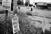 "New Orleans, Louisiana.USA.August 1, 2006..With crime on the rise in much of New Orleans ""Thou Shalt Not Kill"" signs were placed in a busy intersection nearly one year after hurricane Katrina hit and the levees broke leaving 80% of the city flooded.."