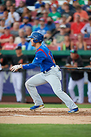 South Bend Cubs right fielder Brandon Hughes (19) follows through on a swing during a game against the Kane County Cougars on July 21, 2018 at Northwestern Medicine Field in Geneva, Illinois.  South Bend defeated Kane County 4-2.  (Mike Janes/Four Seam Images)