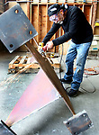 WATERBURY CT. 12 October 2017-101217SV06-Eduardo Giannattasio works on a sculpture in Waterbury Thursday. Five internationally-known Italian artists who wanted to pay homage to sculptor Alexander Calder had the singular idea to create their work in the same place where Calder created his. <br /> Steven Valenti Republican-American