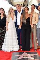 LOS ANGELES, CA. July 24, 2019: Kathy Najimy, Dove Cameron, Kenny Ortega, Monique Coleman & Booboo Stewart at the Hollywood Walk of Fame Star Ceremony honoring Kenny Ortega.<br /> Pictures: Paul Smith/Featureflash
