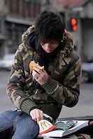 Montreal (Qc) CANADA - Nov 2007 File Photo -<br /> <br /> Emo Teen Student eating McDonald fast food.<br /> <br /> photo : (c)  Images Distribution<br />   eating junk food