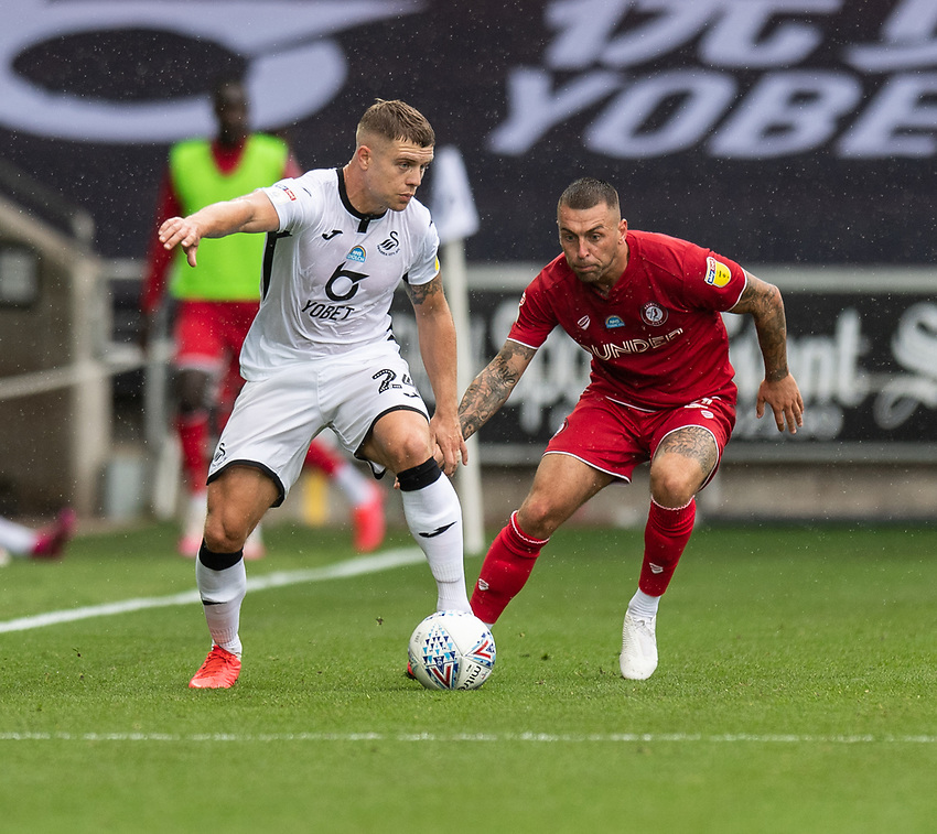 Swansea City's Jake Bidwell (left) under pressure from Bristol City's Jack Hunt (right) <br /> <br /> Photographer David Horton/CameraSport<br /> <br /> The EFL Sky Bet Championship - Swansea City v Bristol City- Saturday 18th July 2020 - Liberty Stadium - Swansea<br /> <br /> World Copyright © 2019 CameraSport. All rights reserved. 43 Linden Ave. Countesthorpe. Leicester. England. LE8 5PG - Tel: +44 (0) 116 277 4147 - admin@camerasport.com - www.camerasport.com