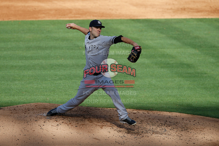 David Phelps #41 of the New York Yankees pitches against the Los Angeles Angels at Angel Stadium on June 15, 2013 in Anaheim, California. (Larry Goren/Four Seam Images)