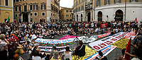 (This photo is an artificial stitch of 4 frames together. It can contain photographic mistakes, and it is part of this story just to show the number of people attending the event).<br />