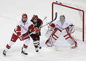 Joe Piskula 7 of the University of Wisconsin and Dan Bertram 22 of Boston College battle for position in front of Brian Elliott 1 of the University of Wisconsin. The Boston College Eagles defeated the University of Wisconsin Badgers 3-0 on Friday, October 27, 2006, at the Kohl Center in Madison, Wisconsin in their first meeting since the 2006 Frozen Four Final which Wisconsin won 2-1 to take the national championship.<br />