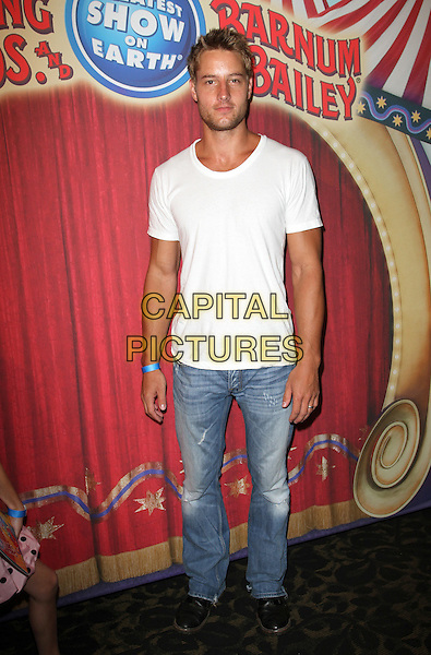 Justin Hartley.Los Angeles premiere of Ringling Bros. and Barnum & Bailey presents Fully Charged Held At The Staples Center Downtown Los Angeles, Los Angeles, California, USA..July 21st, 2011.full length jeans denim white t-shirt.CAP/ADM/KB.©Kevan Brooks/AdMedia/Capital Pictures.