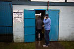Fans queueing at the turnstile before Cambrian and Clydach Vale take on Cwmbran Celtic at King George's New Field in a Welsh League Division One match, the top division of the Welsh Football League and the second level of the Welsh football league system. The club, formed in 1965 reached the final of the 2018-19 League Cup final and can count on ex-England manager Terry Venables as a former club chairman. Cambrian and Clydach Vale won this match 2-0, watch by a crowd of around 100 spectators.