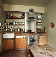 The kitchen area has an old fashioned feel with simple wooden furniture and bare floorboards