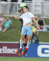 Cat Whitehill #4 of the Washington Freedom goes up for a header against Megan Rapinoe #7 of the Chicago Red Stars during a WPS match at the Maryland Soccerplex, in Boyds Maryland on June 12 2010. The game ended in a 2-2 tie.