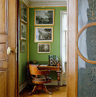 The chair and desk in the corner of Crown Prince Frederick William's study are thought to be designed by Schinkel and the small folding screen is set with family medallions