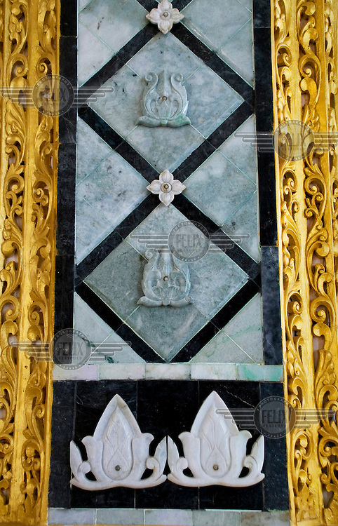 Detail of a pillar in the Pyithu Hluttaw or lower house of Burma's new Parliament. The central inlays are green and white jade from Kachin state.