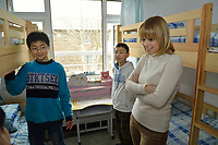 """Swiss singer and TV presenter Francine Jordi chats  Zhang Yu(left),  Qu Xiaobin (right) at their room while visiting """"SOS Kinderdorf"""" in Tianjin, China.  22-Mar-2016"""