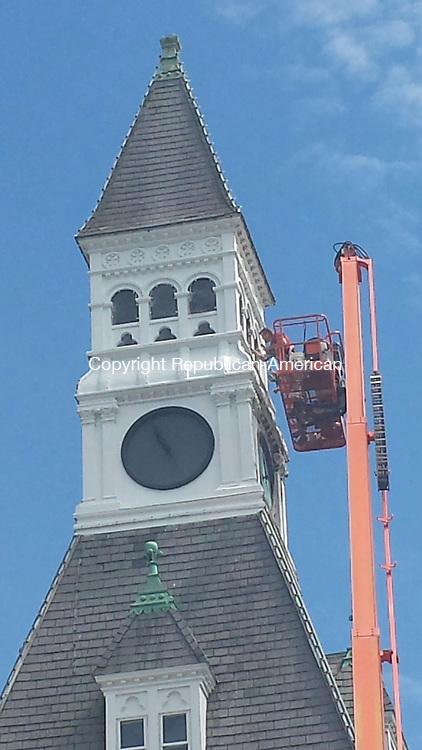 THOMASTON, CT, 05 June 2015 - 060515LW01 - A worker from Osowiecki and Sons replaces rotten wood on the tower at Town Hall in Thomaston Friday morning as part of a project to repair the leaking roof. Laraine Weschler Republican-American