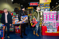 Pictured: Oli McBurnie and Mike van der Hoorn of Swansea City buying children gifts at Smyth's Toy Store, in Swansea, Wales, UK. Wednesday 19 December 2018
