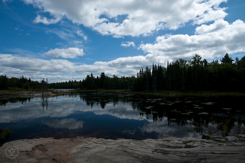 Clouds reflect in the clear waters of an Ontario Lake, Killarney Provincial Park, Ontario, Canada