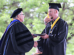 Troy Mason receives his Bachelor's degree in Construction Management from President Mark Ghan during the 2018 Western Nevada College Commencement ceremony, in Carson City, Nev., on Monday, May 21, 2018.  <br /> Photo by Cathleen Allison/Nevada Momentum
