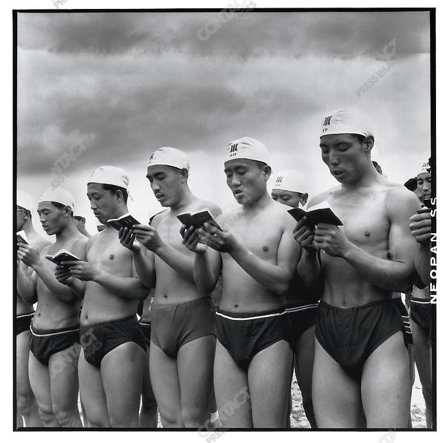 """Swimmers read """"Mao Zedong's thoughts"""" as they prepare to plunge into the Songhua River to commemorate the second anniversary of Mao's swim in the Yangtze; Harbin, Heilongjiang Province, July 16, 1968"""