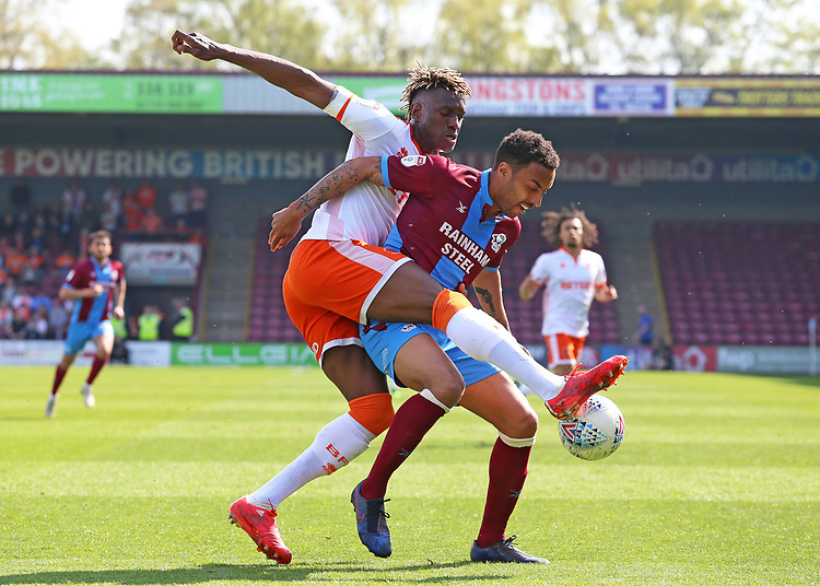 Blackpool's Armand Gnanduillet battles with Scunthorpe United's James Perch<br /> <br /> Photographer David Shipman/CameraSport<br /> <br /> The EFL Sky Bet League One - Scunthorpe United v Blackpool - Friday 19th April 2019 - Glanford Park - Scunthorpe<br /> <br /> World Copyright © 2019 CameraSport. All rights reserved. 43 Linden Ave. Countesthorpe. Leicester. England. LE8 5PG - Tel: +44 (0) 116 277 4147 - admin@camerasport.com - www.camerasport.com