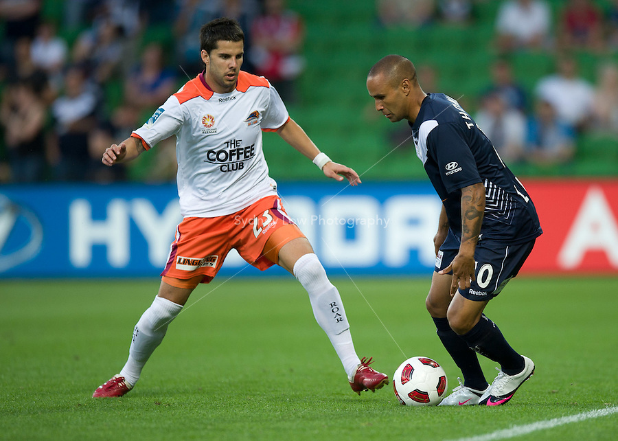 MELBOURNE, AUSTRALIA - DECEMBER 03: Milan Susak of the Roar and Archie Thompson of the Victory compete for the ball during the round 17 A-League match between the Melbourne Victory and the Brisbane Roar at AAMI Park on December 3, 2010 in Melbourne, Australia. (Photo by Sydney Low / Asterisk Images)