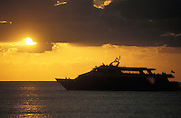 Passenger ferry silhouetted by the setting sun, Isla de Cozumel, Quintana Roo, Mexico