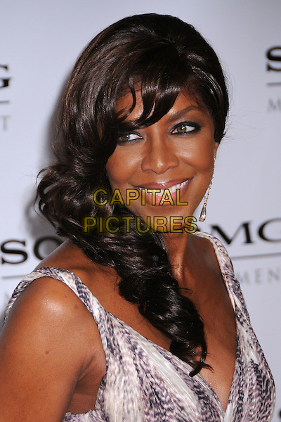 NATALIE COLE<br /> The 2008 Sony BMG Post Grammy Party held at The Beverly Hills Hotel in Beverly Hills, California, USA.<br /> February 10th, 2008 <br /> headshot portrait silver dangling earrings <br /> CAP/ADM/BP<br /> &copy;Byron Purvis/AdMedia/Capital Pictures