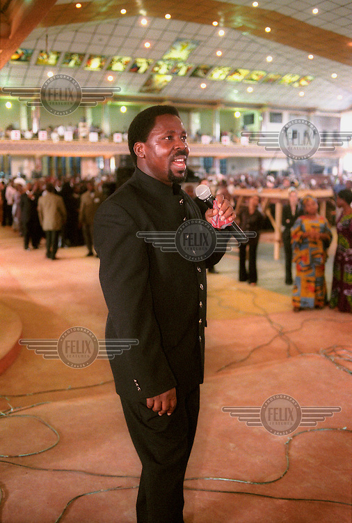 """Pastor Temitope B. Joshua, an evangelical Nigerian prophet who claims to have the power to perform miracles, preaches at The Synagogue Church of All Nations. People come to the church from all over Africa to be """"cured"""" of evils such as AIDS, cancer and infertility."""