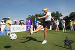 Suzann Pettersen kicks a football at the 14th hole during the World Celebrity Pro-Am 2016 Mission Hills China Golf Tournament on 22 October 2016, in Haikou, China. Photo by Victor Fraile / Power Sport Images