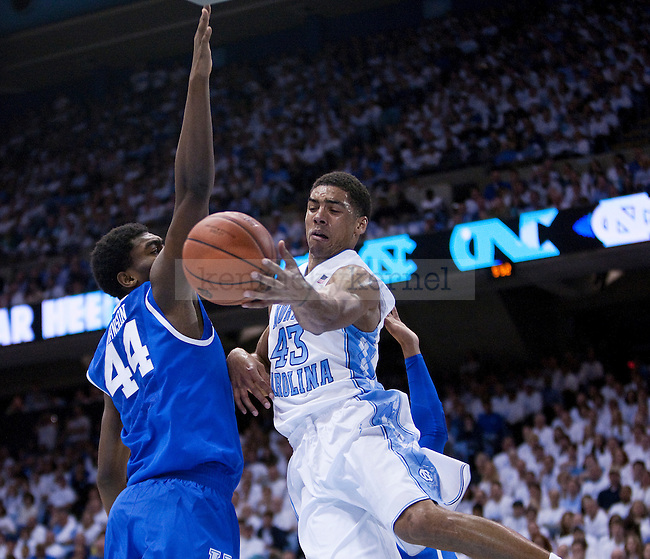 Kentucky Wildcats center Dakari Johnson (44) attempts to guard North Carolina Tar Heels forward James Michael McAdoo (43) from shooting a layup during the UK men's basketball vs. North Carolina at the Dean Smith Center in Chapel Hill, N.C., on Saturday, December 14, 2013. Photo by Emily Wuetcher | Staff