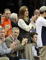 Virginia fan and local celebrity John Grisham, middle, cheers alongside his wife during the game against NC State Saturday in Charlottesville, VA. Virginia defeated NC State 58-55.