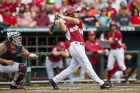 Arkansas Razorbacks outfielder Andrew Benintendi (16) follows through on his swing against the Virginia Cavaliers in Game 1 of the NCAA College World Series on June 13, 2015 at TD Ameritrade Park in Omaha, Nebraska. Virginia defeated Arkansas 5-3. (Andrew Woolley/Four Seam Images)