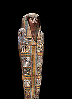 "Ancient Egyptian wooden sarcophagus - the tomb of Tagiaset, Iuefdi & Harwa circa 22nd Dynasty (943 - 716 BC.) Thebes. Egyptian Museum, Turin. black background.<br /> <br /> Coffin lid of the eldest woman buried in the tomb, probably Tagiasettahekat, wife of Padiau. The sarcophagus decoration includes representation of strips crossed over her chest typical of ""stoa coffin"" of the 22nd dynasty."