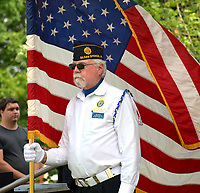 Janelle Jessen/Herald-Leader<br /> Jim Gillig, a member of the American Legion Post 29 color guard, helped with posting the colors during the grand opening ceremony.