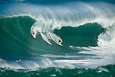 USA, Hawaii, the North Shore Oahu, surfers dropping in on a wave at Waimea bay