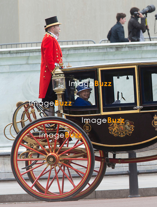 TROOPING THE COLOUR 2013  - London, June 15, 2013. The Queen attended the annual parade but her husband, the Duke of Edinburgh, missed the event as he remained in hospital recovering from surgery.<br /> It ended with a 41-gun salute and RAF flypast, watched by the Royal Family from the balcony of Buckingham Palace.<br /> Pic : Queen Elisabeth II