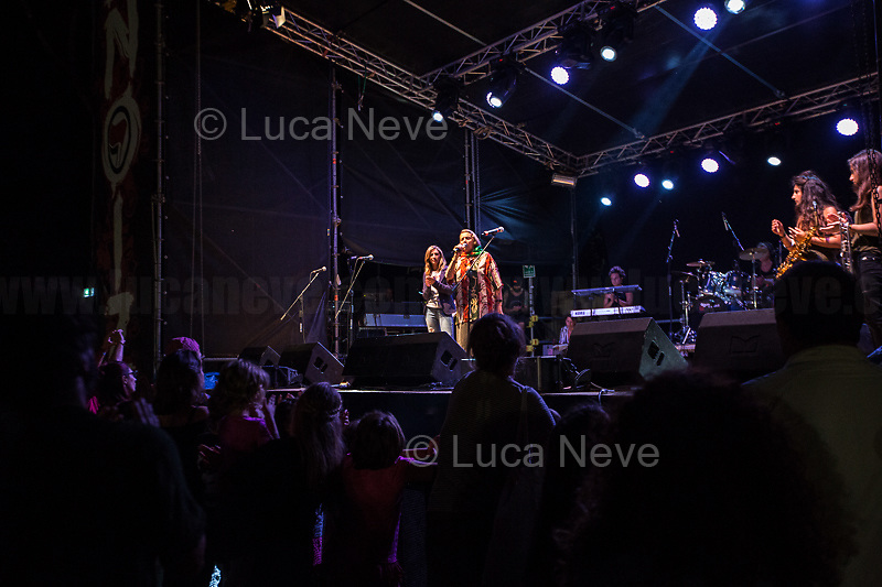 """Tina Costa (Antifascist Partizan. Member of the Partigiani: the Italian Resistance during WWII).<br /> <br /> Rome, 01/09/2018. Documenting the antifascist """"Renoize Festival 2018"""" at Schuster Park in rome. The annual musical, political and cultural event saw various bands playing, including Nosenzo (), Hi Shine (https://bit.ly/2NwFR5o) Feat. Sista Gaia & Sista Anja - Voices of Los3saltos (https://bit.ly/2wYJAhZ) and Clementino (https://bit.ly/2O3lDNA). Special guests of the Festival: Stefania, Mother of Renato Biagetti, the Association """"Madri Per Roma Cittá Aperta"""" and Tina Costa (Partizan, Member of the Italian Resistance during WWII).<br /> The Fesival is dedicated to Renato Biagetti, the 26 year old sound engineer and activist of the Rome's Social Centre Acrobax. Renato Biagetti was stabbed to death the night of the 27 August 2006 by two neo-fascists while he was going back home with his girlfriend and a friend (both attacked and injured as well) after a reggae concert in Focene, on the Lazio's coast near Rome.<br /> <br /> For more info please click here: https://www.facebook.com/events/1997311230582084/ & https://www.facebook.com/12-anni-di-Renato-ionondimentico-1218120291536169/<br /> <br /> For More info about Nosenzo please click here: https://bit.ly/2H0nOSM & https://bit.ly/1IFlc6P & https://bit.ly/2qztM1T & https://bit.ly/2qAhqYe<br /> <br /> For more photos of the Partizan Tina Costa please click here: https://bit.ly/2wTihp2"""