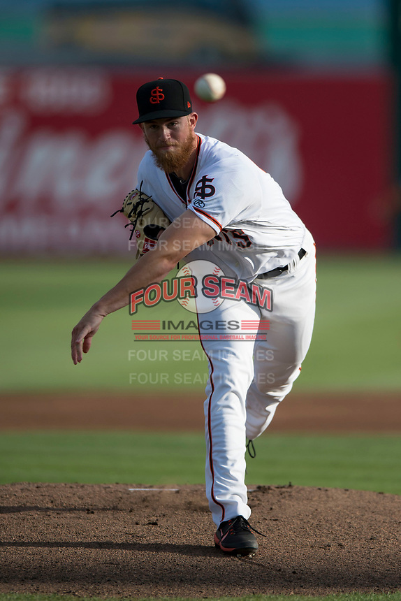 San Jose Giants starting pitcher Conner Menez (34) follows through on his delivery during a California League game against the Modesto Nuts at San Jose Municipal Stadium on May 15, 2018 in San Jose, California. Modesto defeated San Jose 7-5. (Zachary Lucy/Four Seam Images)