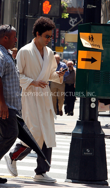 WWW.ACEPIXS.COM . . . . .  ....August 2 2011, New York City....Actor Sacha Baron Cohen and his umberella wielding bodyguard on the set of the new movie 'The Dictator' in midtown Manhattan on August 2 2011 in New York City....Please byline: CURTIS MEANS - ACE PICTURES.... *** ***..Ace Pictures, Inc:  ..Philip Vaughan (212) 243-8787 or (646) 679 0430..e-mail: info@acepixs.com..web: http://www.acepixs.com