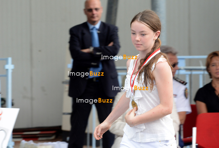 ALEXANDRA OF HANOVRE HONORED WITH MEDAL - Princess Caroline and Charlène Wittstock presented the awards to young people from the NBFA College, including to Alexandra Of Hanovre, the daughter of Princess Caroline ( the school of the daughter of Princess Caroline ) during an olympic day organized by the National.Education and Monegasque Olympic Committee..Monaco, June 20, 2012. Exclusive photos.