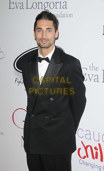 Hugo Taylor.attended the Noble Gift Gala, ME London, The Strand, London, England, UK, 8th December 2012..half length black suit tuxedo tux bow tie .CAP/CAN.©Can Nguyen/Capital Pictures.