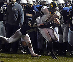 (Lexington MA 10/28/16) Andover QB 4, Ernest Perry, on a first down run, taken down by Lexington 27, Lucas Honohan, during the first half, Friday, Oct 28, 2016, at Lexington High School. (Jim Michaud / Journal Inquirer)