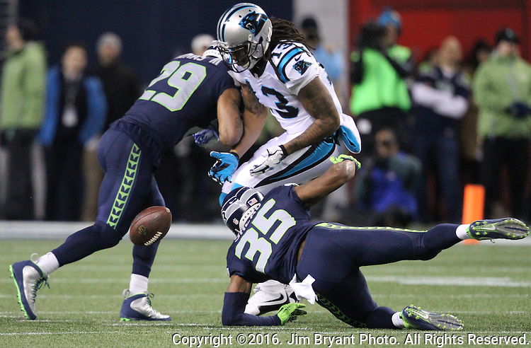 Seattle Seahawks free safety Earl Thomas (29) and Seattle Seahawks strong safety Kam Chancellor (31) break up a pass intended for Carolina Panthers wide receiver Kelvin Benjamin (13) at CenturyLink Field in Seattle, Washington on December 4, 2016.  Seahawks beat the Panthers 40-7.  ©2016. Jim Bryant photo. All Rights Reserved.