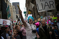 NEW YORK, NY - APRIL 15: Activists shout slogans as they pass near Trump Tower during a Tax Day protest on April 15, 2017 in New York City. Thousands of activists march to Trump Tower to demand that President Donald Trump release his tax returns. Photo by VIEWpress/Eduardo MunozAlvarez