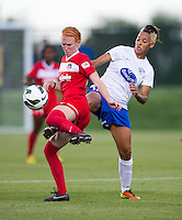 Lianne Sanderson (10) of the Boston Breakers fights for the ball with Tori Huster (23) of the Washington Spirit during the game at the Maryland SoccerPlex in Boyds, MD.  Washington tied Boston, 1-1.