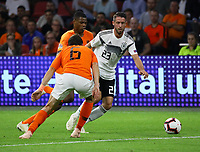 Mark Uth (Deutschland Germany) gegen Marten de Roon (Niederlande, Netherlands) und Denzel Dumfries (Niederlande) - 13.10.2018: Niederlande vs. Deutschland, 3. Spieltag UEFA Nations League, Johann Cruijff Arena Amsterdam, DISCLAIMER: DFB regulations prohibit any use of photographs as image sequences and/or quasi-video.