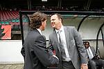 Nederland, Nijmegen, 10 mei 2012.Seizoen 2011/2012.Eredivisie.N.E.C.-Vitesse 3-2.Alex Pastoor trainer-coach van N.E.C. geeft John van den Brom trainer-coach van Vitesse een hand voor de wedstrijd.