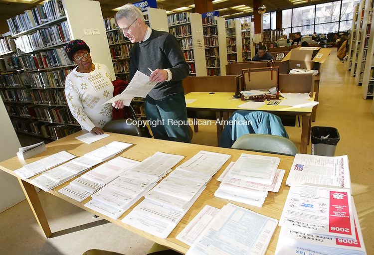 WATERBURY, CT, 03/07/07- 030707BZ06-  John Staver, of Watertown, of Volunteers Income Tax Assistance (VITA), helps Gladys Passmore, of Waterbury, prepare her income tax returns at the Silas Bronson Library in Waterbury Wednesday afternoon.  According to the IRS Website, VITA volunteers are certified to help prepare basic tax returns in communities across the country.  The VITA program at the Silas Bronson Library is held between 3 p.m. and 7 p.m. on Wednesday's.  Staver said an average of 25 people show up each week for the free help even though he is only able to service 10 to 12 daily. &quot;One day I had 37 people lined up,&quot; he said.  In addition to VITA  the AARP also offers free tax preparation at the Library on Tuesday's and Wednesday's between the hours of 10 a.m. and 1 p.m.  Both programs continue through April 11, 2007.<br /> Jamison C. Bazinet Republican-American