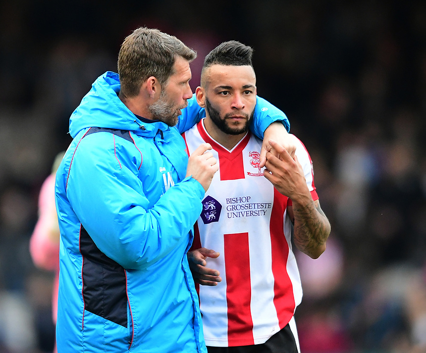 Lincoln City's goalkeeping coach Jimmy Walker, left, and Lincoln City's Nathan Arnold at the end of the game <br /> <br /> Photographer Chris Vaughan/CameraSport<br /> <br /> Vanarama National League - Lincoln City v Torquay United - Friday 14th April 2016  - Sincil Bank - Lincoln<br /> <br /> World Copyright &copy; 2017 CameraSport. All rights reserved. 43 Linden Ave. Countesthorpe. Leicester. England. LE8 5PG - Tel: +44 (0) 116 277 4147 - admin@camerasport.com - www.camerasport.com
